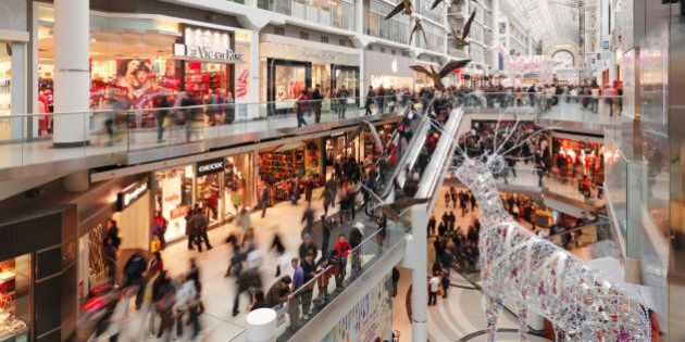 Eaton Centre largest shopping mall in downtown Toronto full of people on Boxing day in 2011. Ontario,