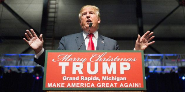 GRAND RAPIDS, MI - DECEMBER 21: Republican presidential candidate Donald Trump speaks to guests at a...