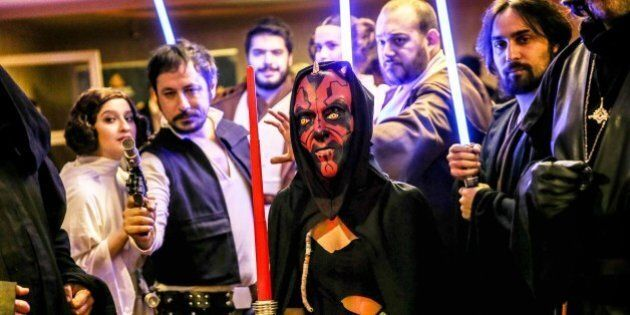 ISTANBUL, TURKEY - DECEMBER 16: Performers, suited as movie characters, pose during Turkish premiere of 'Star Wars: The Force Awakens' at Profilo Shopping Mall in Istanbul, Turkey on December 16, 2015. (Photo by Berk Ozkan/Anadolu Agency/Getty Images)