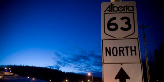 FORT MCMURRAY, ALBERTA, CANADA - NOVEMBER 2008: Trucks and cars can be seen continuously driving along...