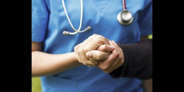 Doctor helping old patient with Alzheimer's