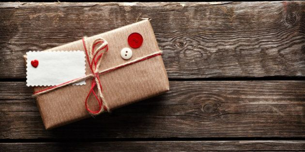 Vintage gift box (package) with blank gift tag on old wooden