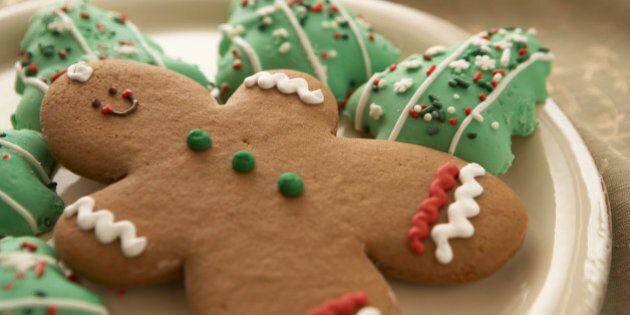 Gingerbread man and Christmas cookies on plate, elevated