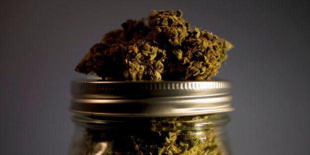 Marijuana strain on top of jar full of