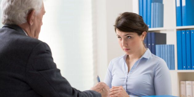 Young woman talking to a manager about new