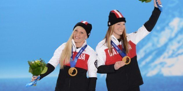 A picture taken with a robotic camera shows (from L) shows Canada's gold medalists pilot Kaillie Humphries...