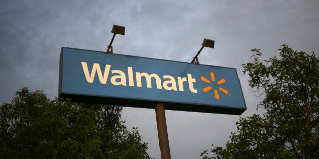 Wal-Mart Stores Inc. signage is displayed outside of a store in Louisville, Kentucky, U.S., on Friday,...