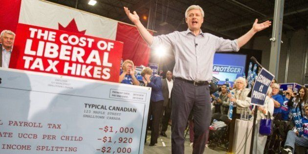 Conservative leader Stephen Harper speaks to supporters at a rally in London, Ontario on October 13,...
