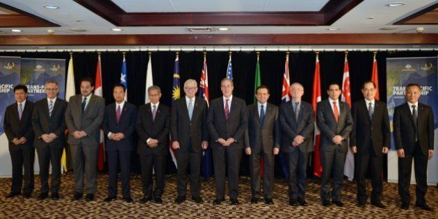 A family photo shows trade ministers from the Trans-Pacific Partnership (TPP), a pan-Pacific trade agreement...