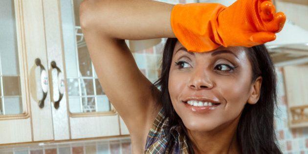 Beautiful housewife washing the