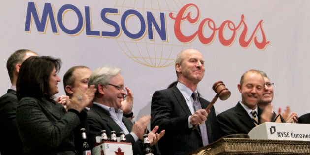 Peter Swinburn, president and chief executive officer of Molson Coors Brewing Company, pounds the gavel...