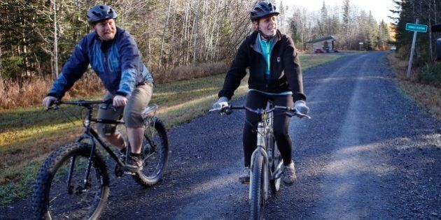 Nurse Kaci Hickox, right, and her boyfriend, Ted Wilbur ride bikes on a trail near her home in Fort Kent,...
