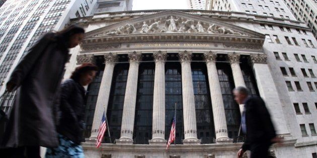 People walk past the New York Stock Exchange (NYSE) building on March 11, 2015 in New York. The average...