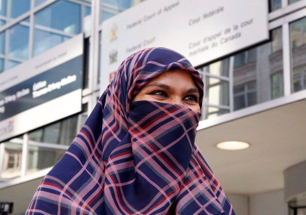 Zunera Ishaq talks to reporters outside the Federal Court of Appeal after her case was heard in Ottawa on Sept. 15, 2015.