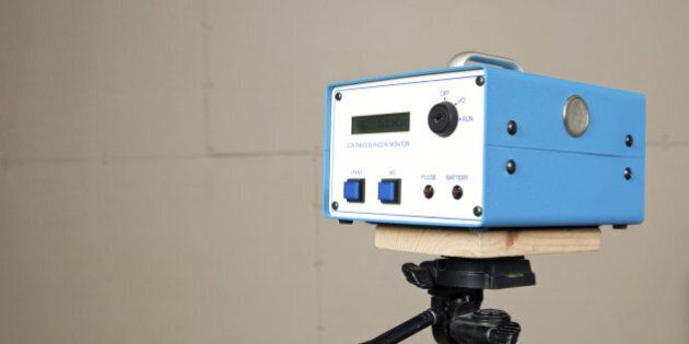 'A continuous radon monitor is mounted to a tripod in an unfinished house basement. A house is commonly...