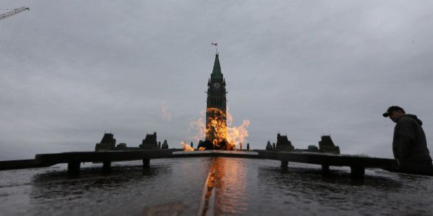 OTTAWA, ON - NOVEMBER 10:Tourists visit the Centennial Flame, lit in 1967 by Lester B. Pearson burns...