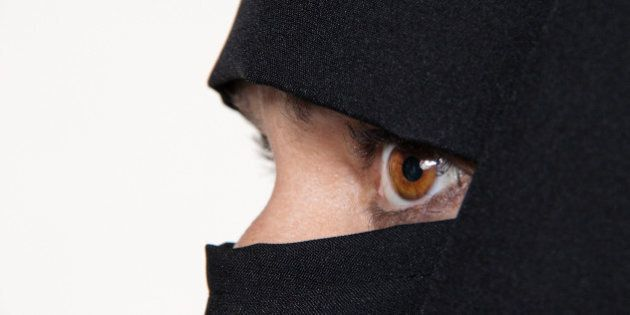 Symbol photo Islam. Muslim woman is veiled with a