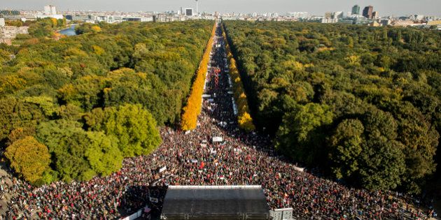 BERLIN, GERMANY - OCTOBER 10: More than 100.000 protesters gather to demonstrate against the TTIP and...