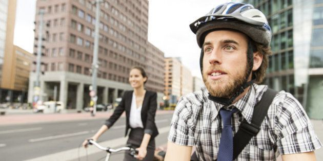 Man and woman commuting with bicycle.