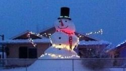 B.C. Man Builds Snowman Taller Than His