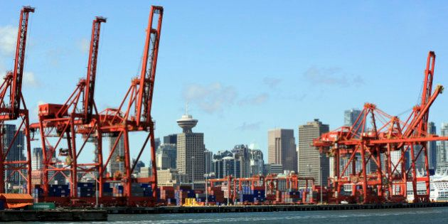 Cranes and containers at Vancouver Port & skyline