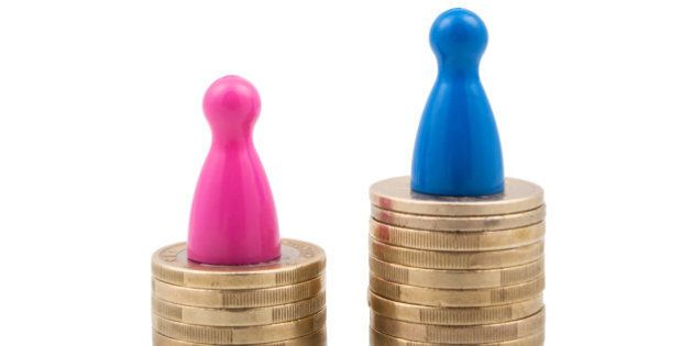 Pink and blue figures on different coin stacks. Concept for gender pay