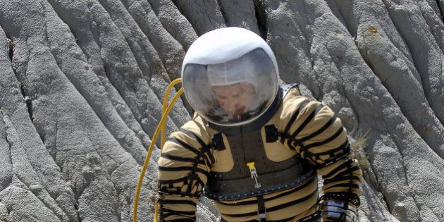 University of North Dakota Space Studies graduate studen Fabio Sau tests out a experimental planetary...