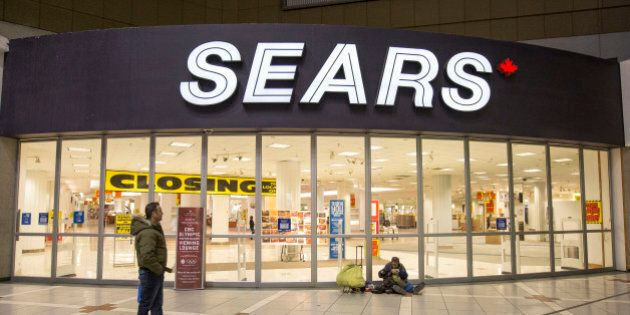 TORONTO, ON - FEBRUARY 23  - The doors of the Sears at Eaton Centre are seen closed for the last time. Photographs showing the Sears store located at the Eaton Centre on it's last day of operations. February 23, 2014.        (Carlos Osorio/Toronto Star via Getty Images)