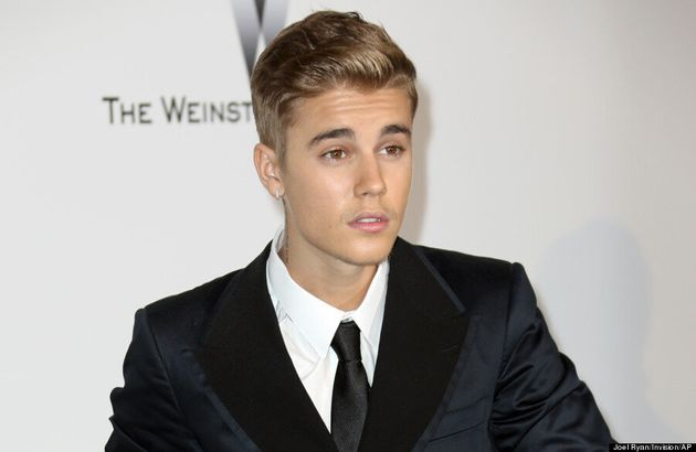 Justin Bieber Takes His Blond Hair To First Public