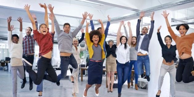 Shot of office staff jumping