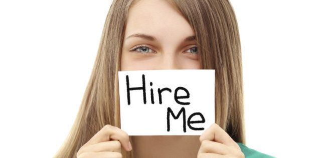 Girl asking to get hired Sign saying 'Hire