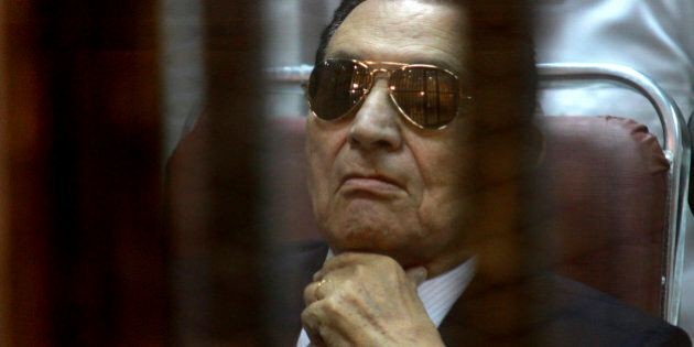 FILE-- In this Saturday, April 26, 2014 file photo, ousted Egyptian President Hosni Mubarak attends a hearing in his retrial over charges of failing to stop killings of protesters during the 2011 uprising that led to his downfall, in the  Police Academy-turned-court in the outskirts of Cairo, Egypt. On Wednesday, May 21, 2014 an Egyptian court has convicted ousted President Hosni Mubarak of embezzlement and sentenced him to three years in prison. Mubarak's two sons, one-time heir apparent Gamal and wealthy businessman Alaa, were also convicted of graft and sentenced to four years in prison each. (AP Photo/Tarek el Gabbas, File)
