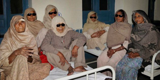 Indian elderly women who went blind following cataract surgeries performed at a free medical camp run...