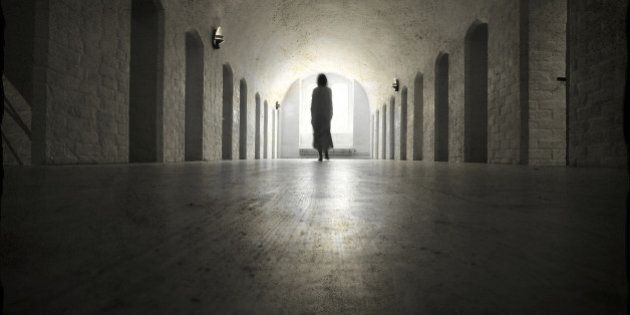 Ghost in an old medieval lunatic asylum.