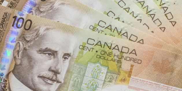 Canadian currency, hundred dollar bills, fanned