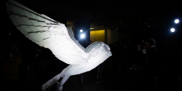 Toronto, Canada - October, 3 2015 - Visual artist, Ekow Nimako, sculpted a tribute to the barn owl using...