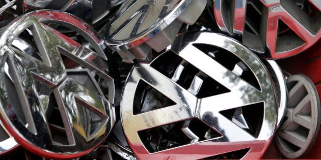 Volkswagen ornaments sit in a box in a scrap yard in Berlin, Germany, Wednesday, Sept. 23, 2015. The...