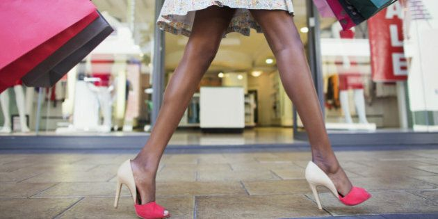 Woman carrying shopping bags in shopping