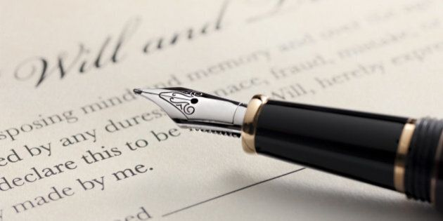 Last will and testament document with closeup on fountain pen with signature line. Critical focus on...