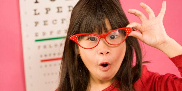 Girl wearing eyeglasses in front of eye