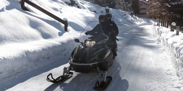 Police patrol with a new snowmobile around the helicopter airfield «Stilli» at Davos. World Economic...