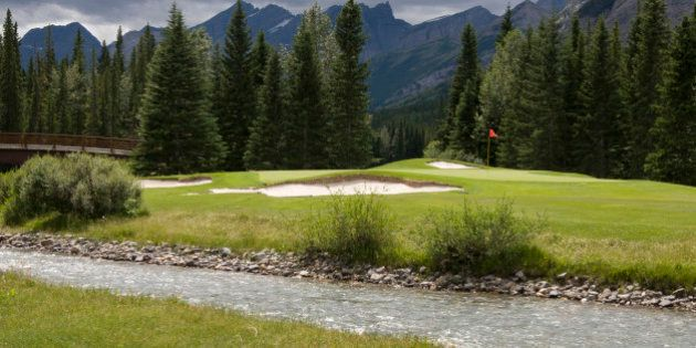'Sun peeks through the Clouds on a cloudy day. Par 3 Golf Hole in Kananaskis Country, Alberta, Canada.......If...