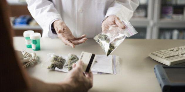 Pharmacist and customer with medical marijuana