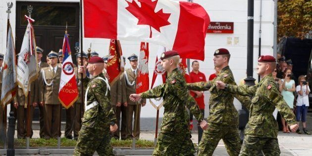 A military unit from Canada marches during a military parade marking Polish Armed Forces Day, in Warsaw,...