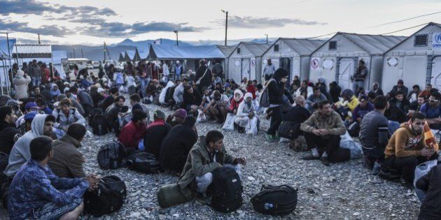 Migrants and refugees wait to board a train near Gevgelija in southern Macedonia after crossing the Greek-Macedonian...