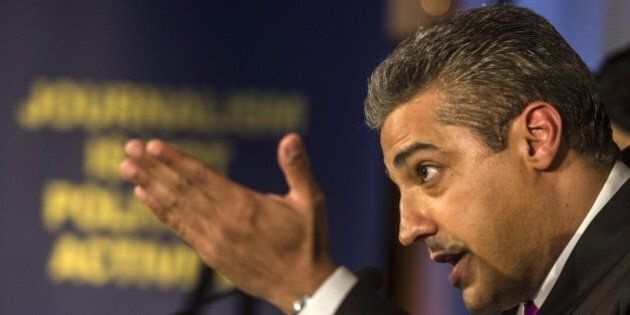 Egyptian-Canadian journalist Mohamed Fahmy, formerly with Al-Jazeera, attends a press conference in Cairo on May 11, 2015. Fahmy, who was sentenced last year to up to 10 years in prison, has sued his Qatari employer for $100 million, his lawyers said, claiming the satellite network was negligent and supported blacklisted Islamists. AFP PHOTO / KHALED DESOUKI (Photo credit should read KHALED DESOUKI/AFP/Getty Images)