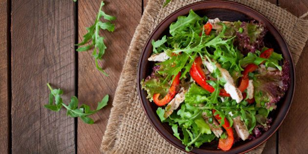 Dietary salad with chicken, arugula and sweet red