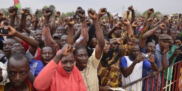 Burkinese opposition supporters shout slogans during a protest at Nation Square in Ouagadougou on January...