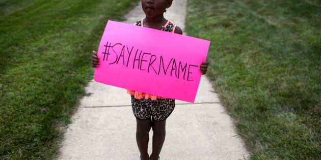 LISLE, IL - JULY 25: Daija Belcher, 5, holds a sign in front of the DuPage African Methodist Episcopal...
