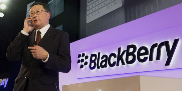 John Chen, chief executive officer of BlackBerry Ltd., speaks on a Passport smartphone during a Bloomberg...